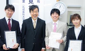 左から五十嵐氏、澤田典均会長、三田村氏、田村氏